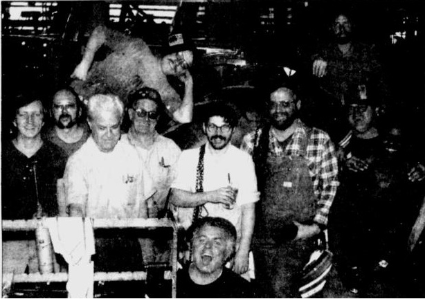 """Friday was the last day on the job for most of the tractor assembly liner workers a the Allis-Chalmers plant in West Allis, and men clowned around in front of a tractor while their friends took pictures.""(Milwaukee Journal Dec. 7, 1985. Page 22)"